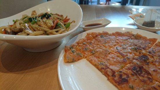 Kimchi pancakes and bowl with udon noodles
